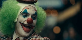 Joaquin Phoenix laughing as Joker in Joker Movie